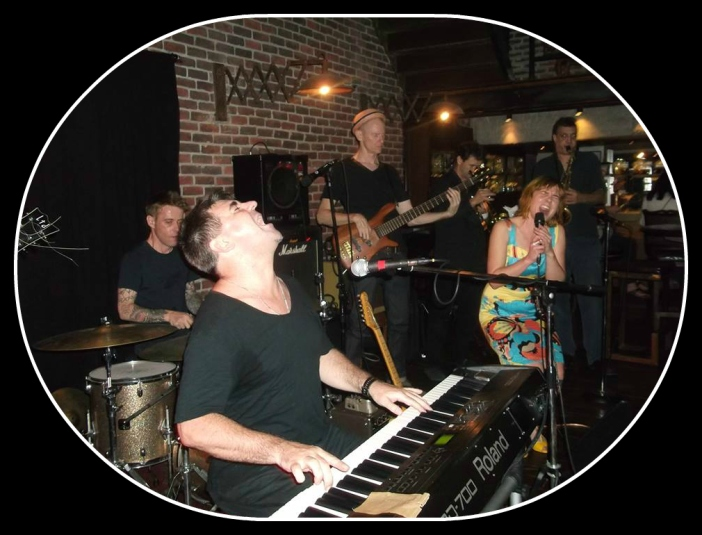 Zerafina sings with a keys player (Keith Nolan), saxaphone player, guitarist, bass guitarist and drummer